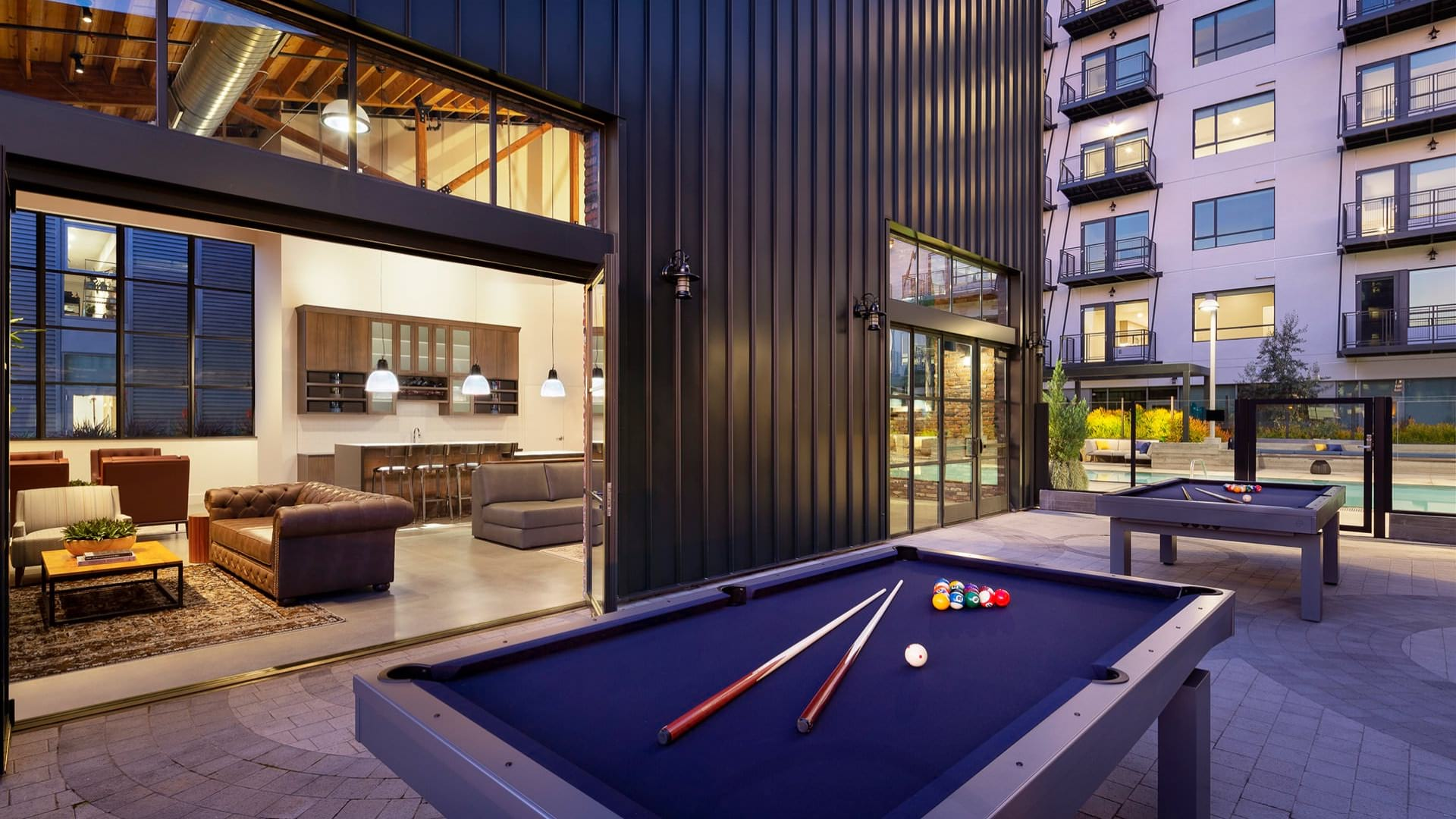 billiard tables on outdoor patio outside of clubroom